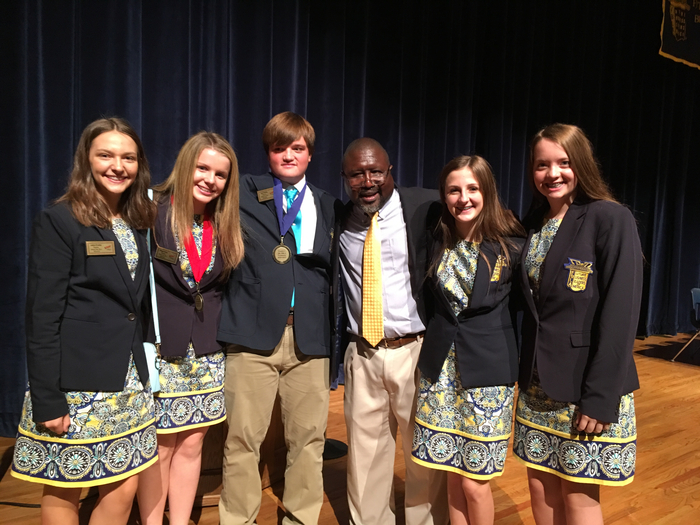 District Officers with keynote speaker, Patrick George
