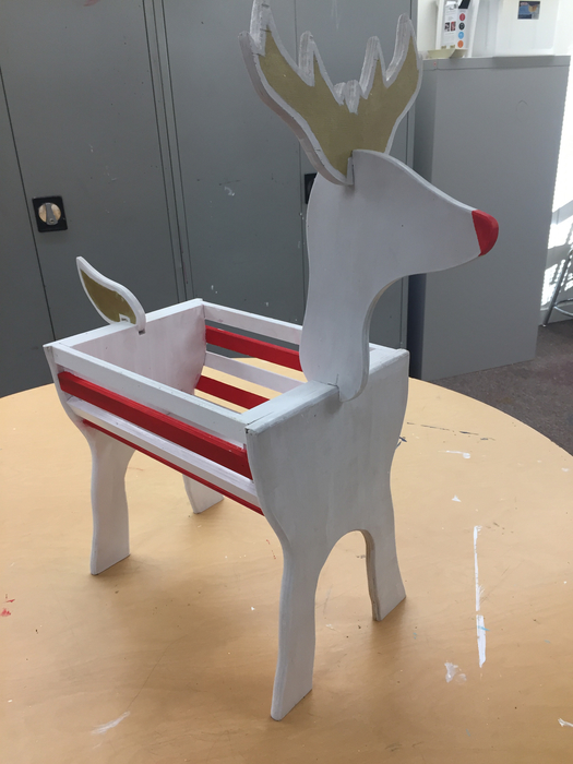 Red, white, and gold deer.