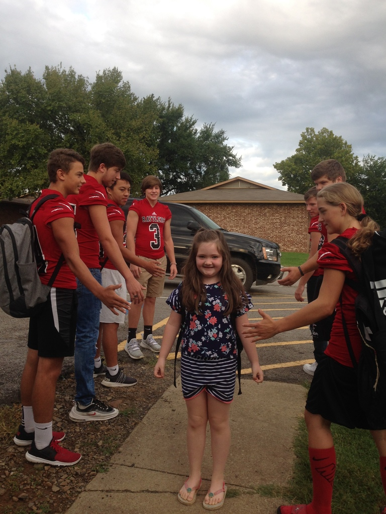 Students greeted by the football players